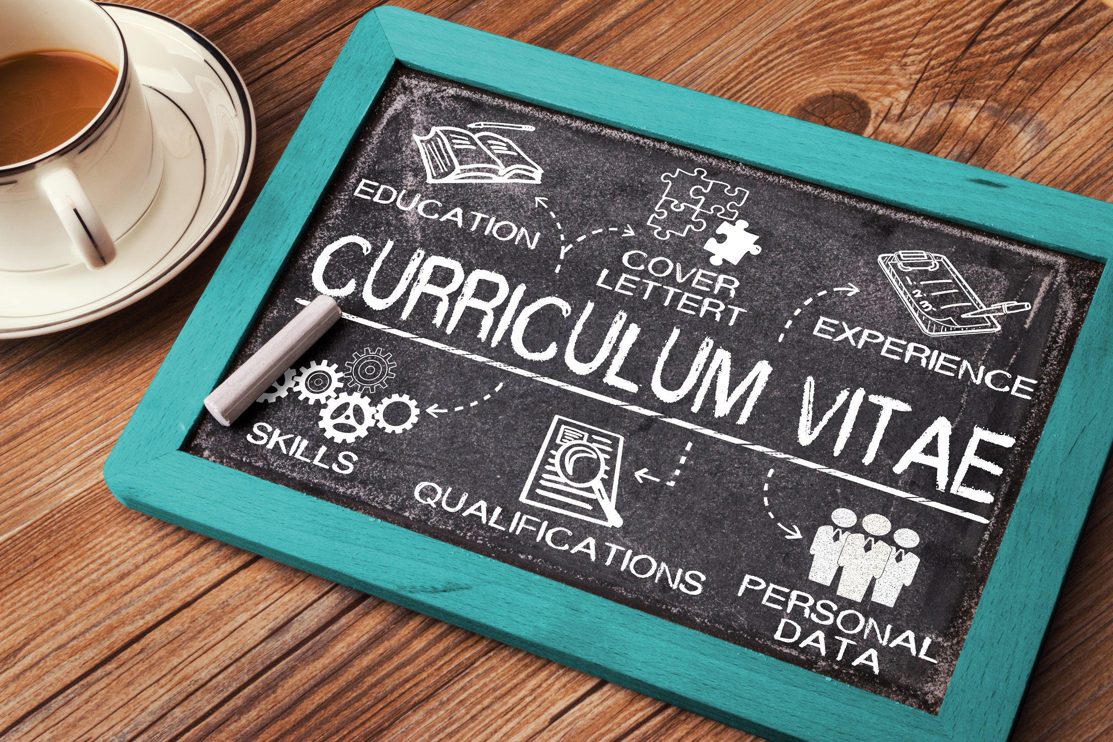 Photo of curriculum vitae and laptop