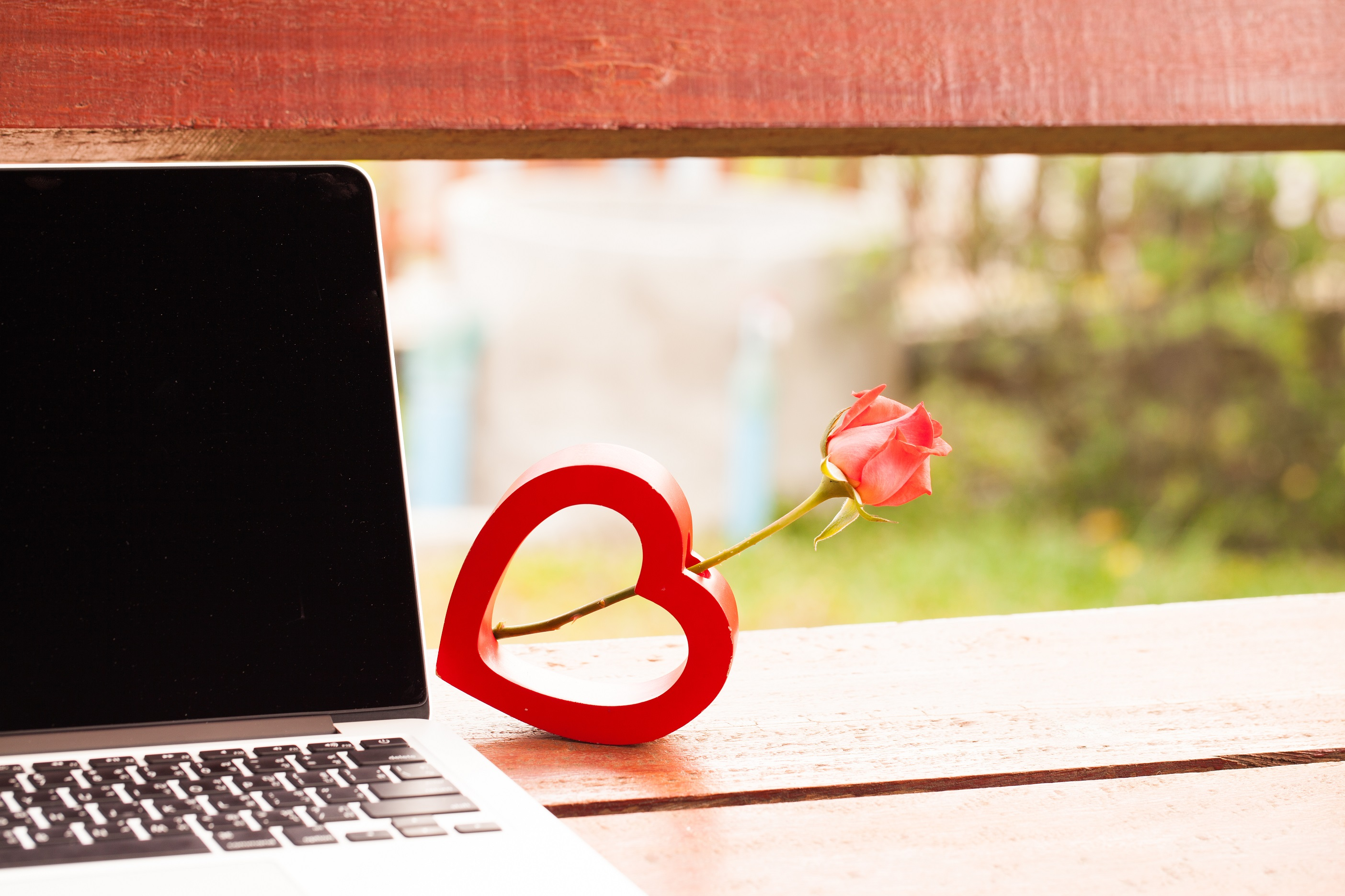 Laptop with rose and Valentine's Day stand