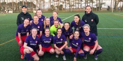 Wymondham Town Football Club Ladies 1st Team group shot of them celebrating their semi final win