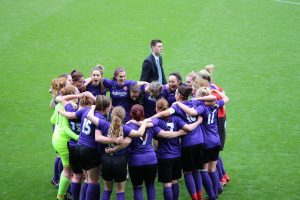 Wymondham Ladies Celebrating their amazing cup final win and all hugging together
