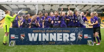 Wymondham Town ladies win the Norfolk County Ladies Cup and pose with their trophy